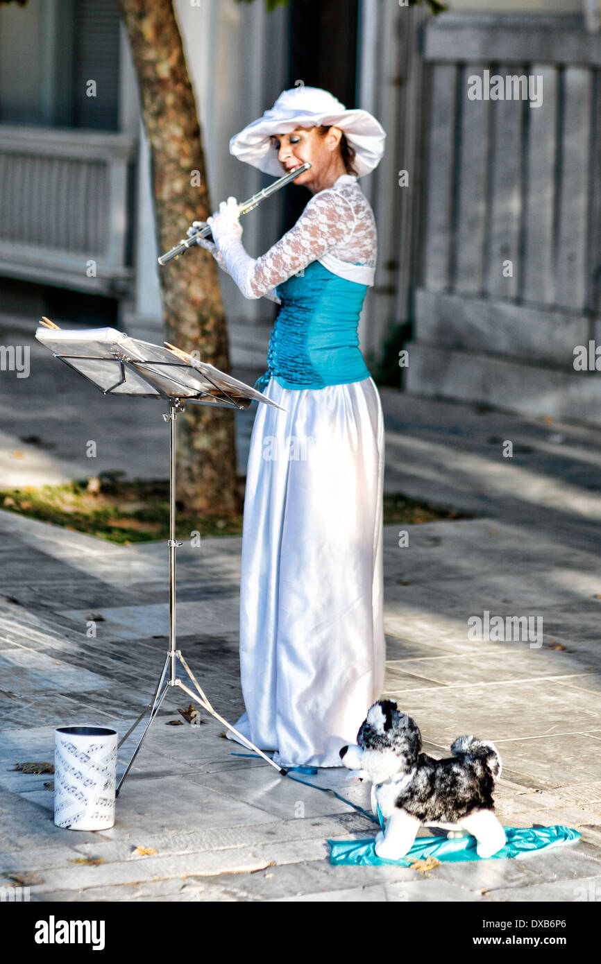 A musician playing flute in the street of Athens, Greece - Stock Image