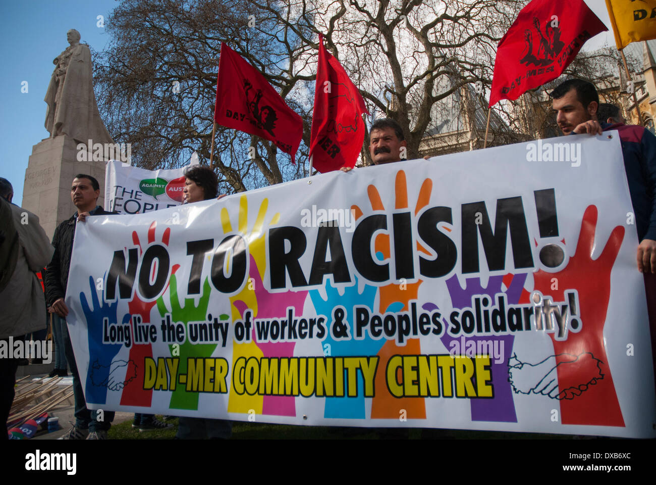 London, UK. 22nd March 2014. People gathered at Old Palace Yard hold up a No To Racism banner prior to the Anti-Racism rally setting off for Trafalgar Square in central London. Credit:  Peter Manning/Alamy Live News - Stock Image