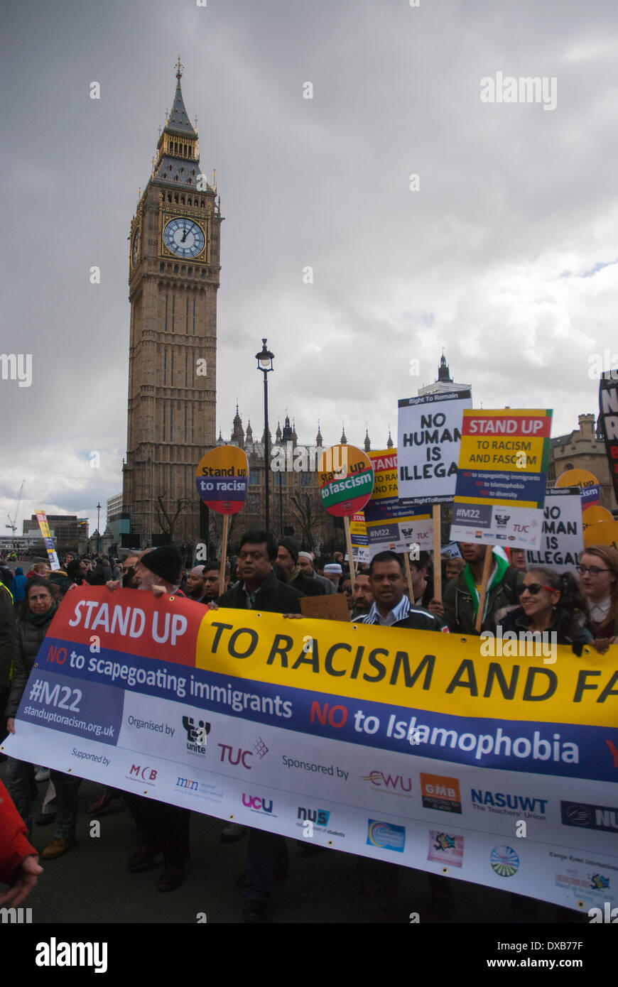 London, UK. 22nd March 2014. The Anti-Racism rally marches past London's iconic Big Ben clock tower. Credit:  Peter Manning/Alamy Live News - Stock Image