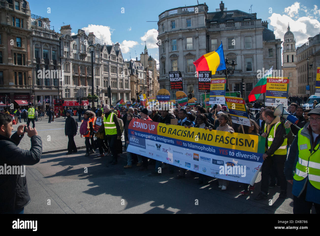 London, UK. 22nd March 2014. The Anti-Racism rally moves towards central London's Trafalgar Square as people hold large banners. Credit:  Peter Manning/Alamy Live News - Stock Image