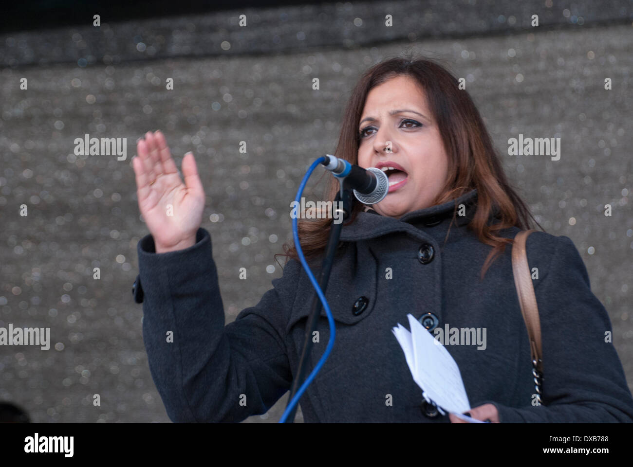 London, UK. 22nd March 2014. Unite Against Fascism Joint secretary Sabby Dhalu addresses the Anti-Racism rally in London's Trafalgar Square. Credit:  Peter Manning/Alamy Live News - Stock Image
