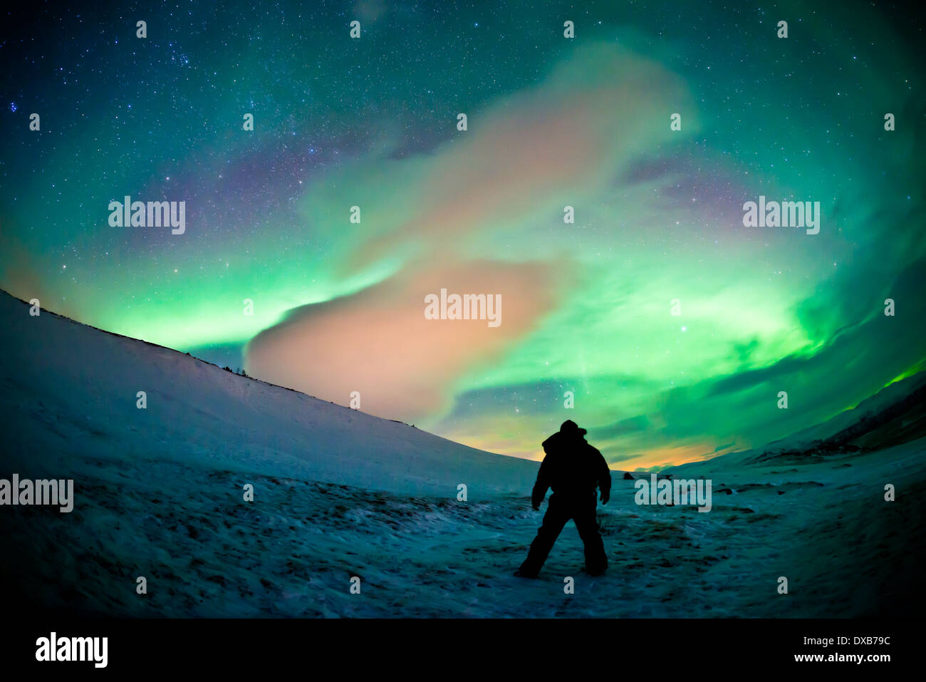 A sky filling Northern Lights (aurora borealis) display over Northern Sweden. High ISO - contains noise. - Stock Image