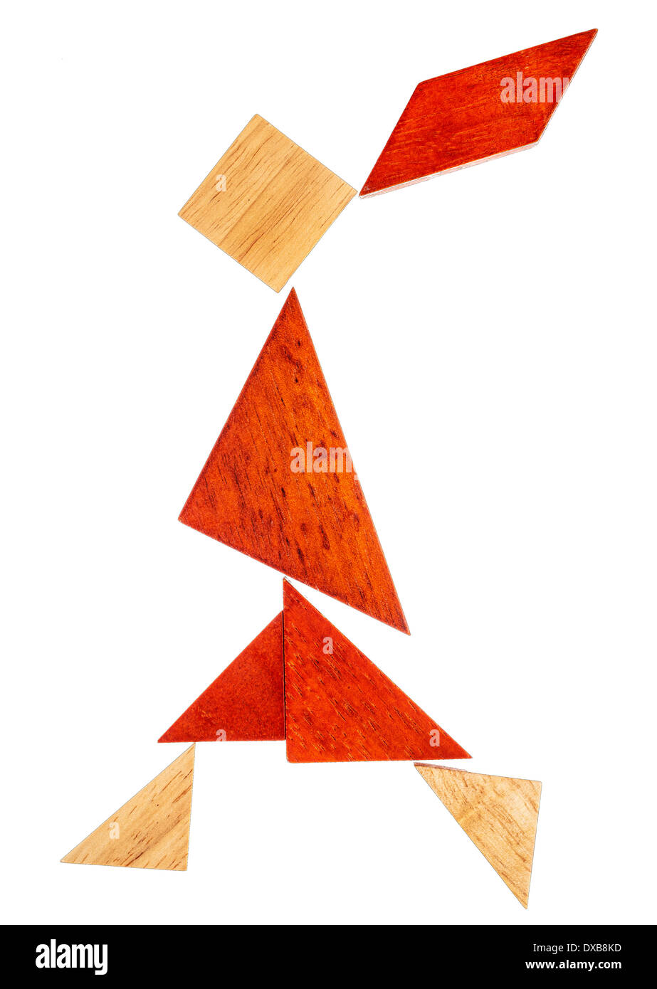 abstract figure of a walking or running girl built from seven tangram wooden pieces, a traditional Chinese puzzle game - Stock Image