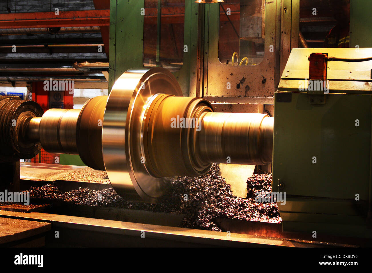 Turning large steel roll to renew surface. - Stock Image
