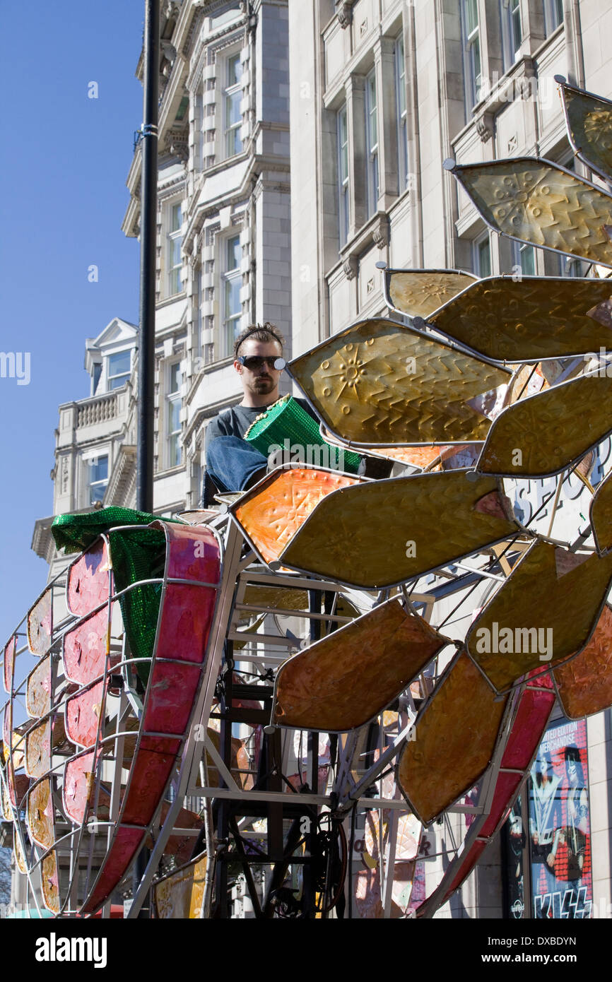 Puppeteer operating the hydraulics of a Phoenix in London - Stock Image