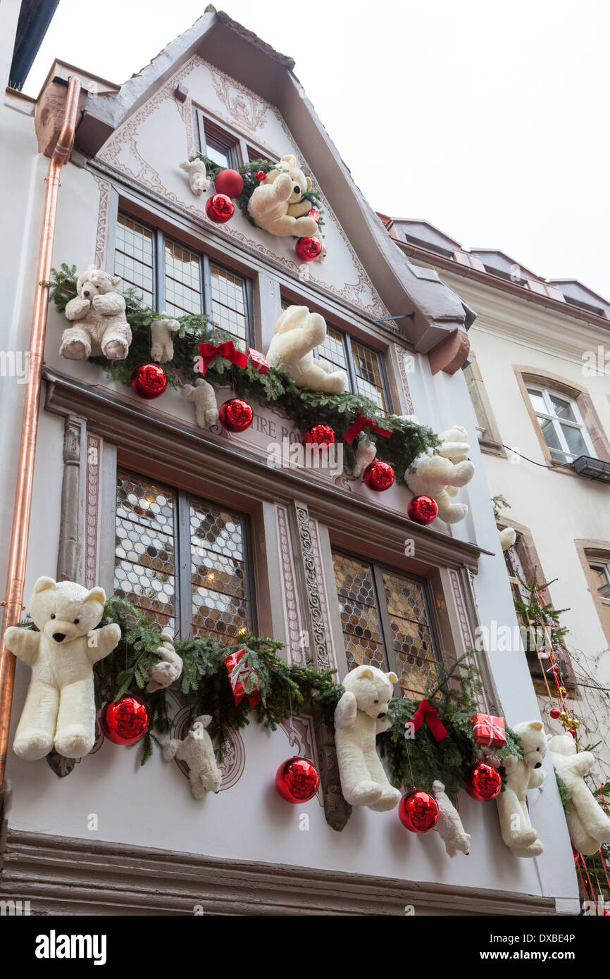 teddy bears as christmas decorations on the exterior of au tire bouchon strasbourg france