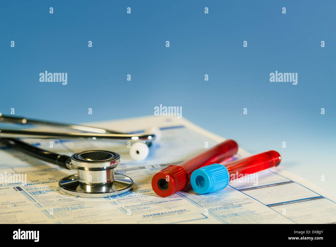 Blood sample and stethoscope - Stock Image