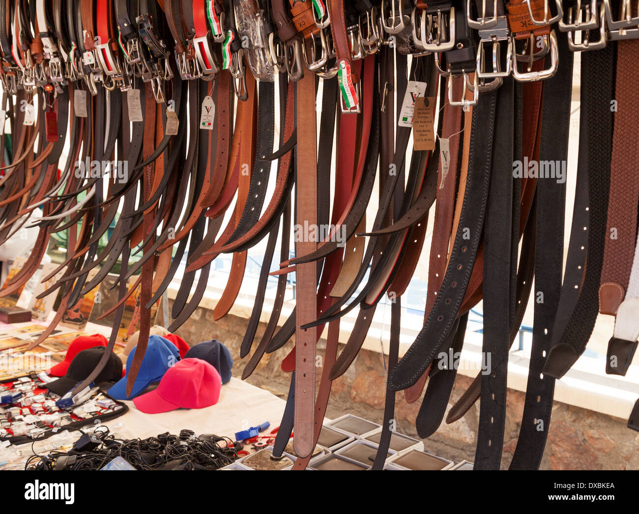 Leather belts for sale in Villaricos village market, Almeria Andalusia, Spain Europe - Stock Image