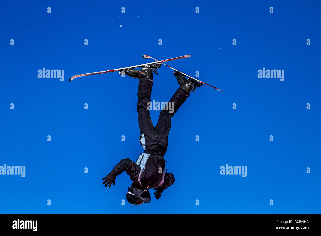 Out of control skier upside down - Stock Image