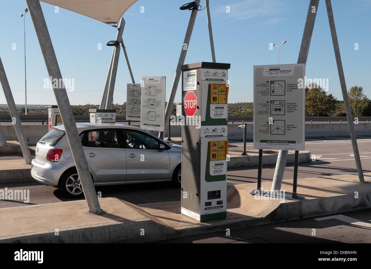 Car parked at an Electronic Toll point on the A22 motorway in southern Portugal (Algave). - Stock Image