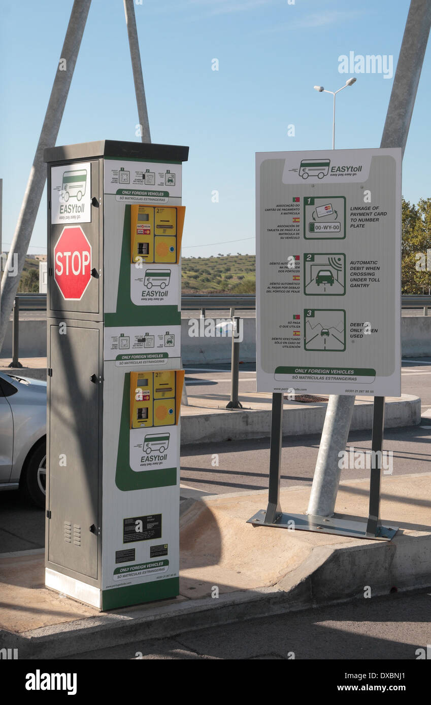 Credit card driver-side payment machine and sign at an Electronic Toll point on the A22 motorway in southern Portugal (Algave). - Stock Image
