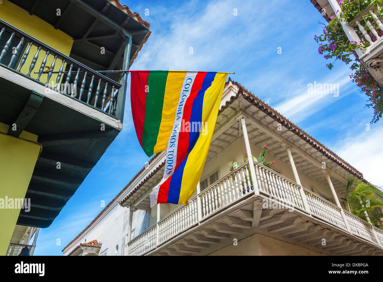 Colonial balconies with a Colombian flag in the historic center of Cartagena, Colombia - Stock Image