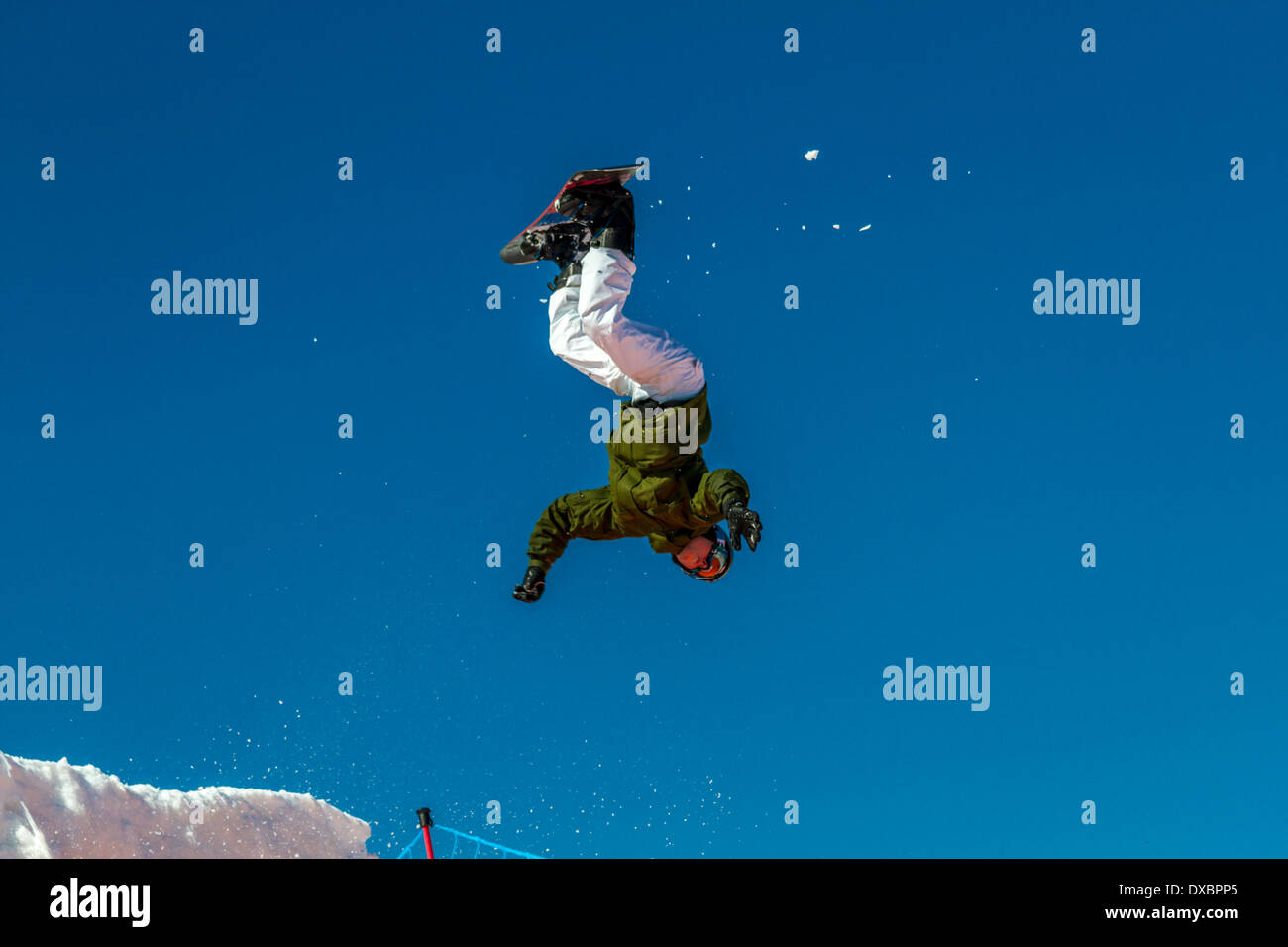Airborne snowboarder about to land in a heap on a giant airbag Stock Photo