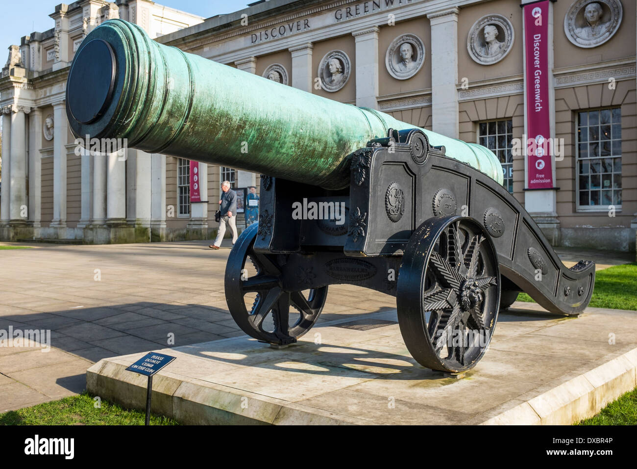 Old historic cannon outside Discover Greenwich Visitor Centre - London SE10 - Stock Image