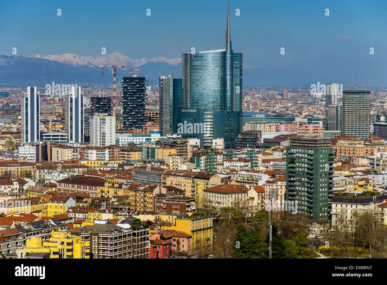 City skyline with Porta Nuova business district and the Alps behind, Milan, Lombardy, Italy - Stock Image