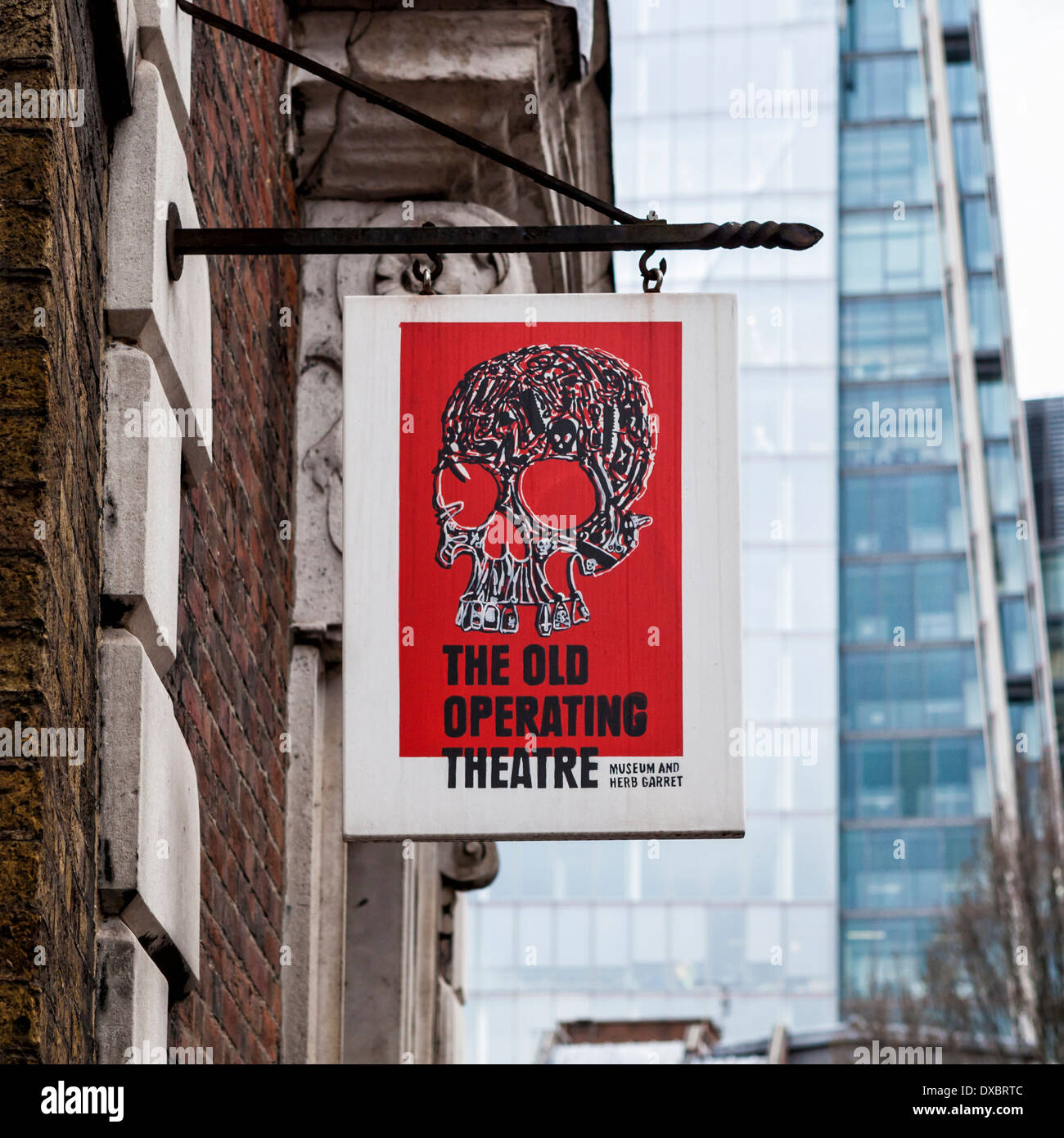 Old Operating Theatre museum and Herb Garret. Red sign with skull and crossbones at entrance - St Thomas Street, London, Uk - Stock Image