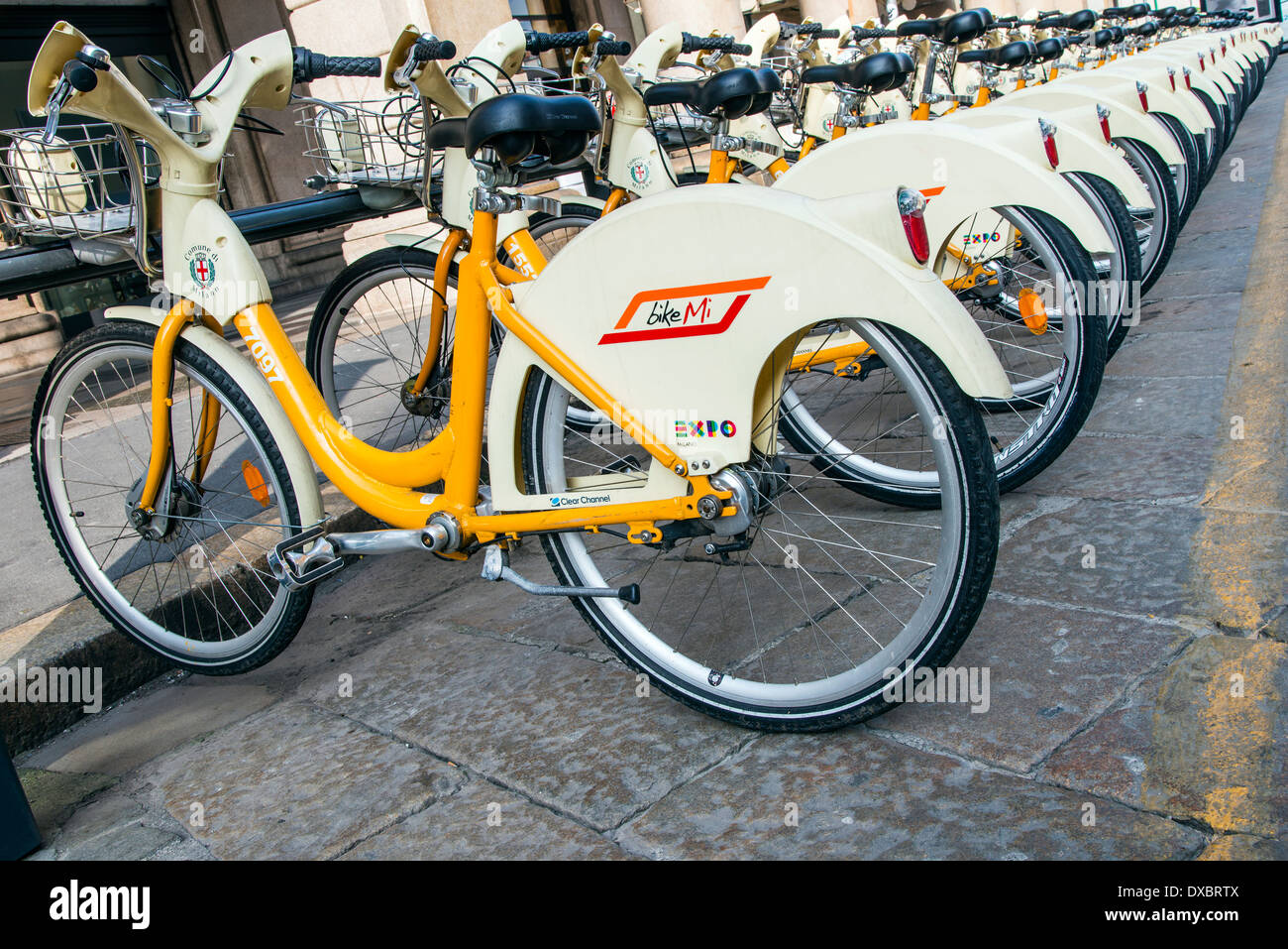 Parked renting bikes in Milan, Lombardy, Italy - Stock Image