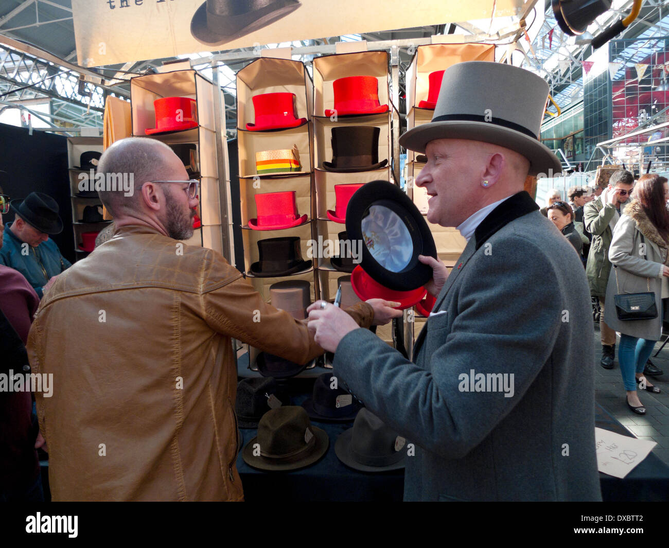 A hat seller selling top hats in Victorian Spitalfields Market near Brick Lane and Liverpool Street Station in East London E1 England UK KATHY DEWITT - Stock Image
