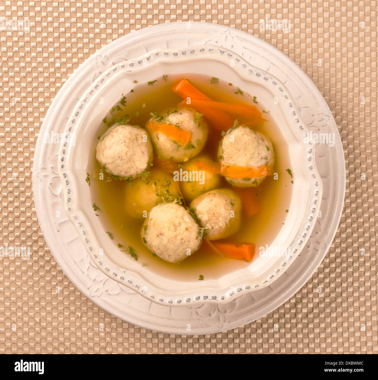 Traditional Matzah Ball Soup for Jewish Passover - Stock Image