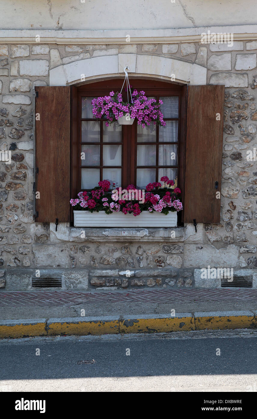 Window with window box and hanging basket, le Bec Hellouin, Normandy, France - Stock Image