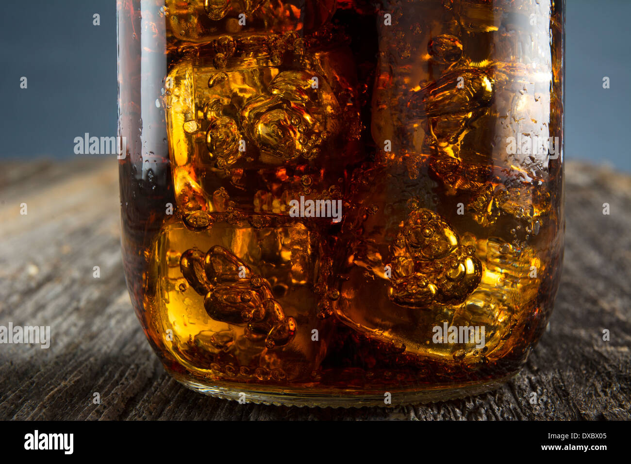 Closeup of Cuba Libre or rum and cola drink with ice in mason jar - Stock Image