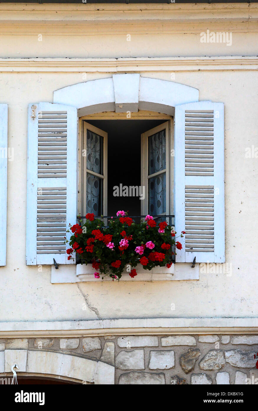 Window with window box and flowers, in the pretty little village of le Bec Hellouin, Normandy, France - Stock Image