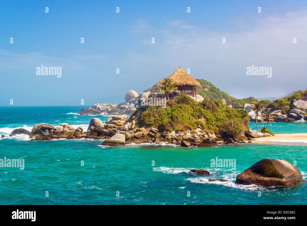 Turquoise water and beach shack at Cabo San Juan del Guia in Tayrona National Park in Colombia - Stock Image