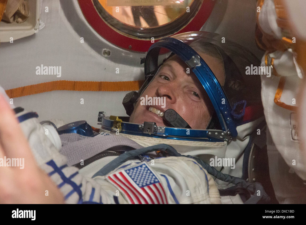International Space Station expedition 39 crew member astronaut Steve Swanson of NASA in the Soyuz TMA-12M spacecraft during final training at the Integration Facility at the Baikonur Cosmodrome March 14, 2014 in Baikonur Kazakhstan. Launch of the crew is scheduled for March 26 for a six-month mission aboard the International Space Station. - Stock Image
