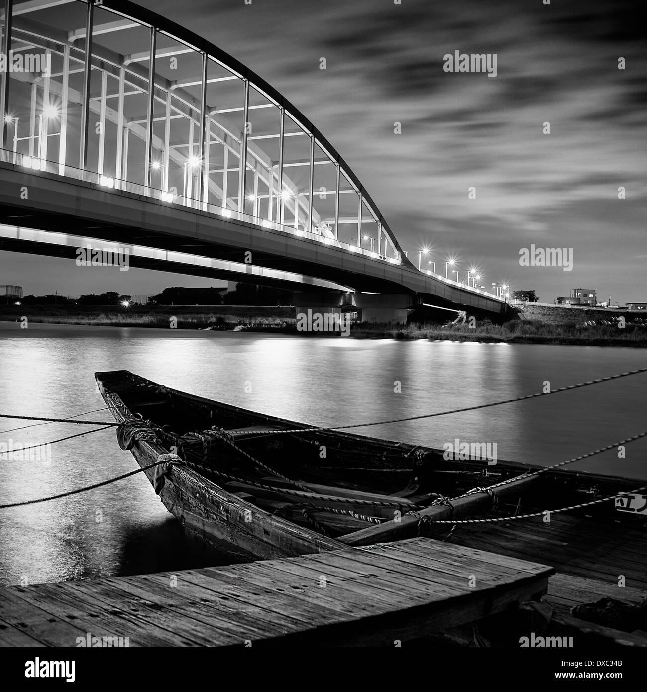 Boat And Bridge at Tama River, Kanagawa Prefecture, Japan - Stock Image