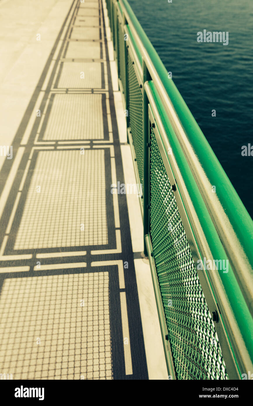 Ferry boat deck with railing and shadow, Puget Sound, Washington, stock photo - Stock Image