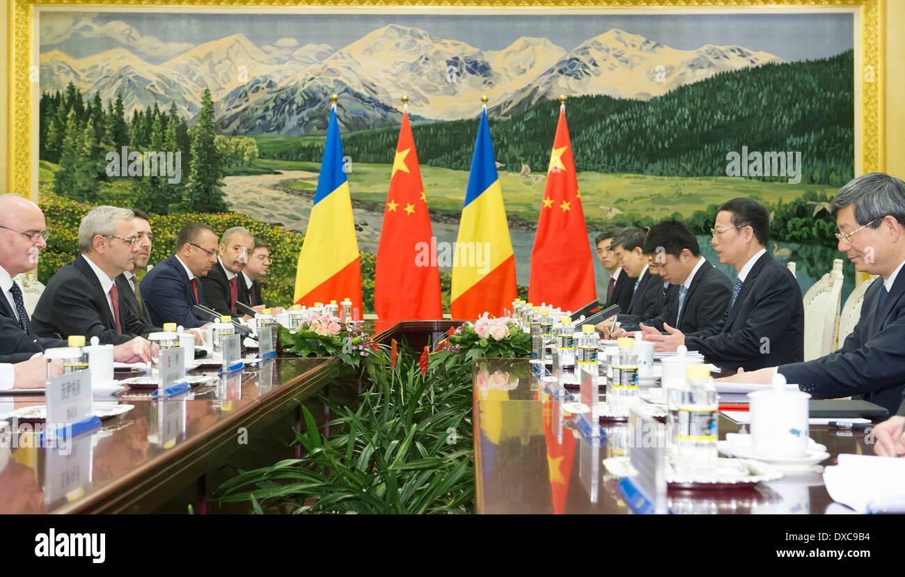 Beijing, China. 24th Mar, 2014. Chinese Vice Premier Zhang Gaoli holds talks with Romanian Deputy Premier Liviu Dragnea in Beijing, capital of China, March 24, 2014. © Huang Jingwen/Xinhua/Alamy Live News - Stock Image