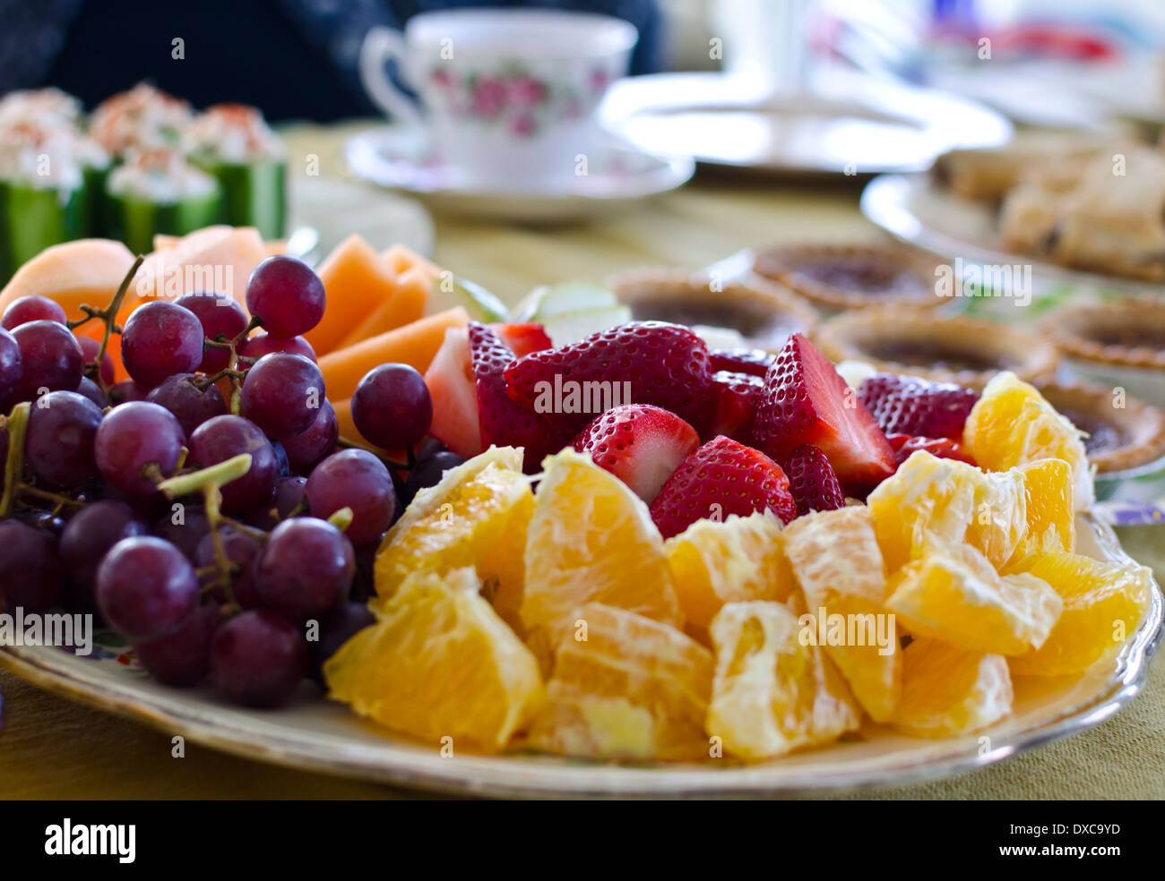 Plate of cut up fruit -oranges, grapes, strawberries and cantaloupe ...