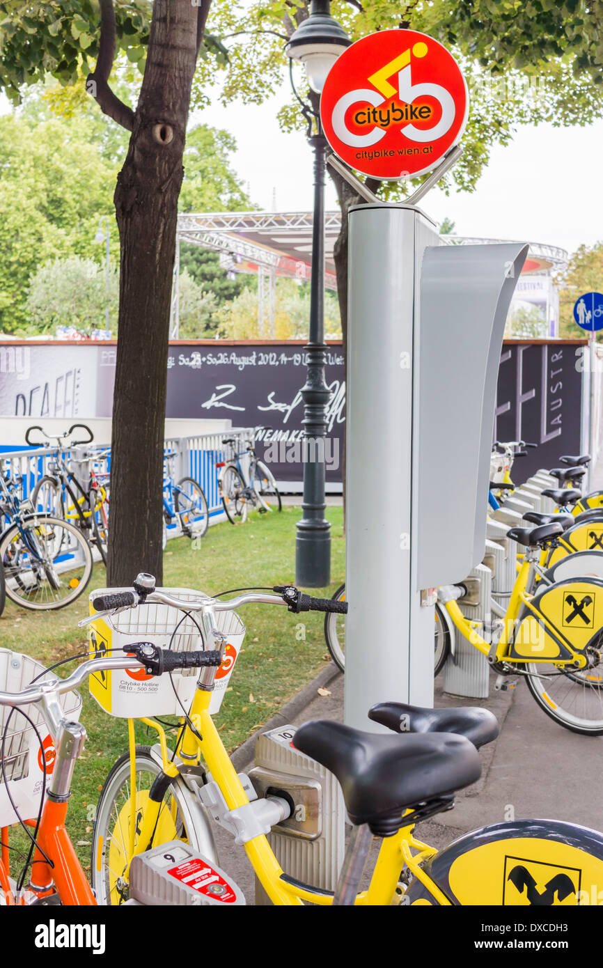 bicycles at a station of the viennese bike sharing system _city bike_, vienna, austria - Stock Image