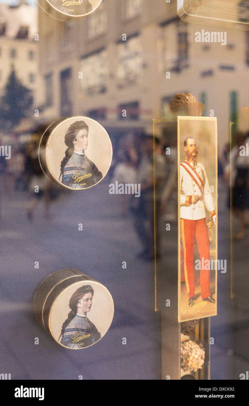 chocolate wrapping with the portraits of elisabeth (sisi) and franz-joseph 1st in a shop window of the cake shop gerstner - Stock Image