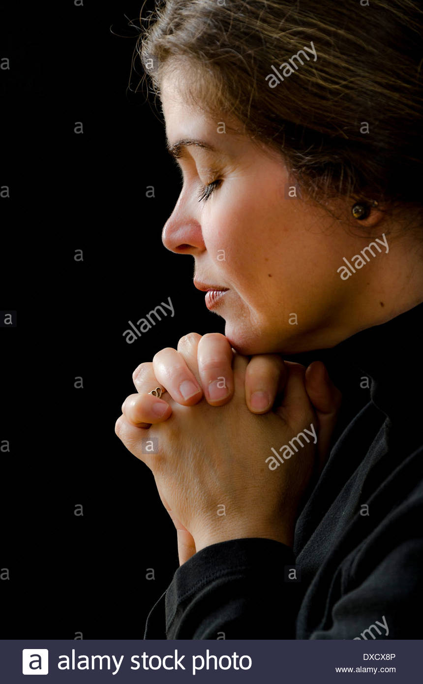 Hispanic woman having her daily devotional with God. Religious life. Worship and adoration of a pious woman Stock Photo