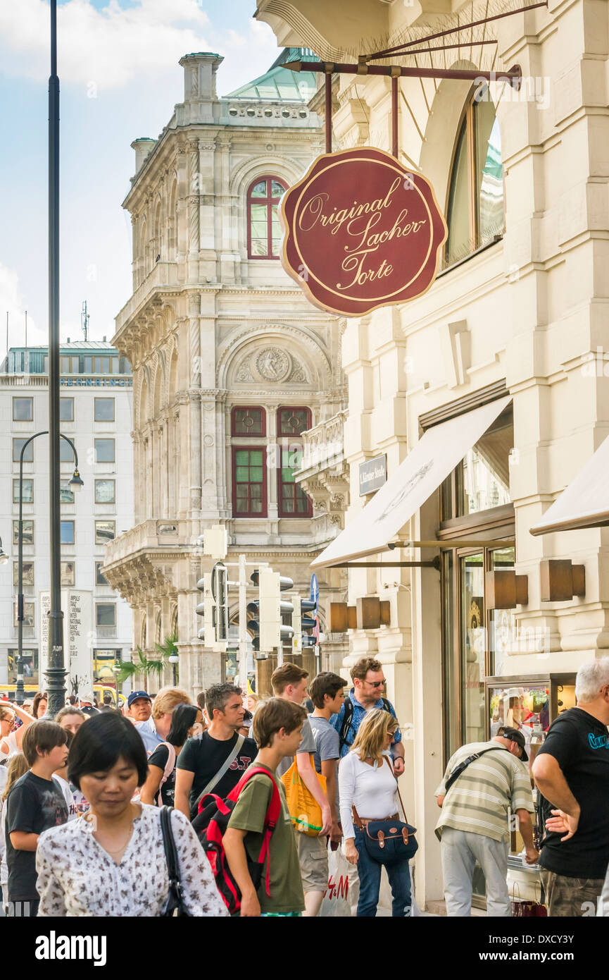 street scene downtown vienna, kaerntnerstrasse, hotel café sacher, in the upper middle a sign that reads: original sacher cake - Stock Image