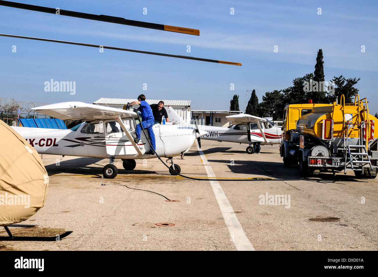refueling a private airplane at an airstrip - Stock Image