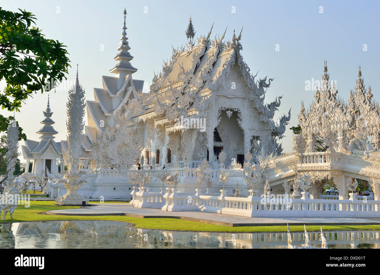 "Wat Rong Khun,better known as ""the White Temple"" is  in the style of a Buddhist temple is one of the most recognizable Stock Photo"