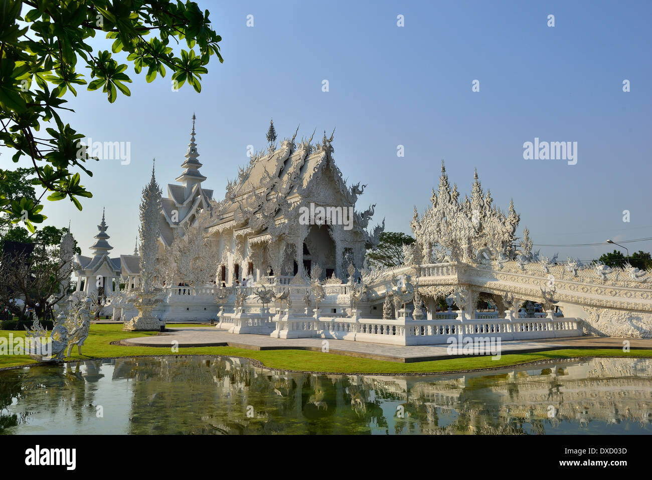 """Wat Rong Khun,better known as """"the White Temple"""" is  in the style of a Buddhist temple is one of the most recognizable Stock Photo"""