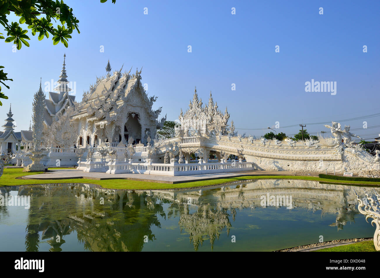 """Wat Rong Khun,better known as """"the White Temple"""" is  in the style of a Buddhist temple is one of the most recognizable temples - Stock Image"""