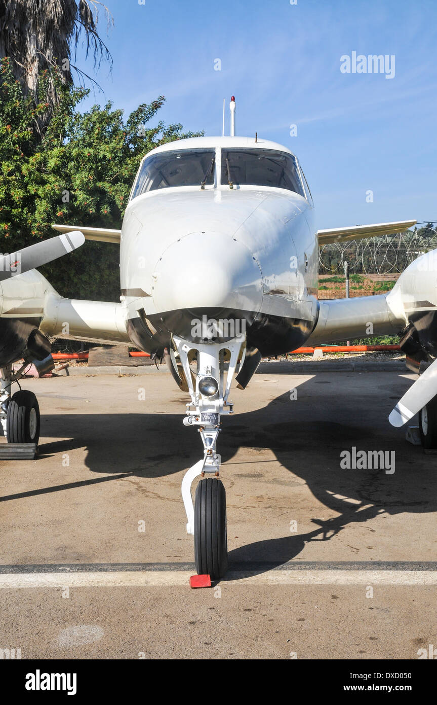 close-up of the front wheel mechanism on a private plane - Stock Image