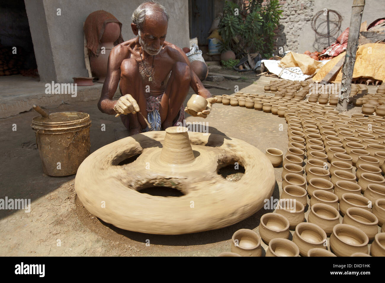 how to make clay pots with a wheel