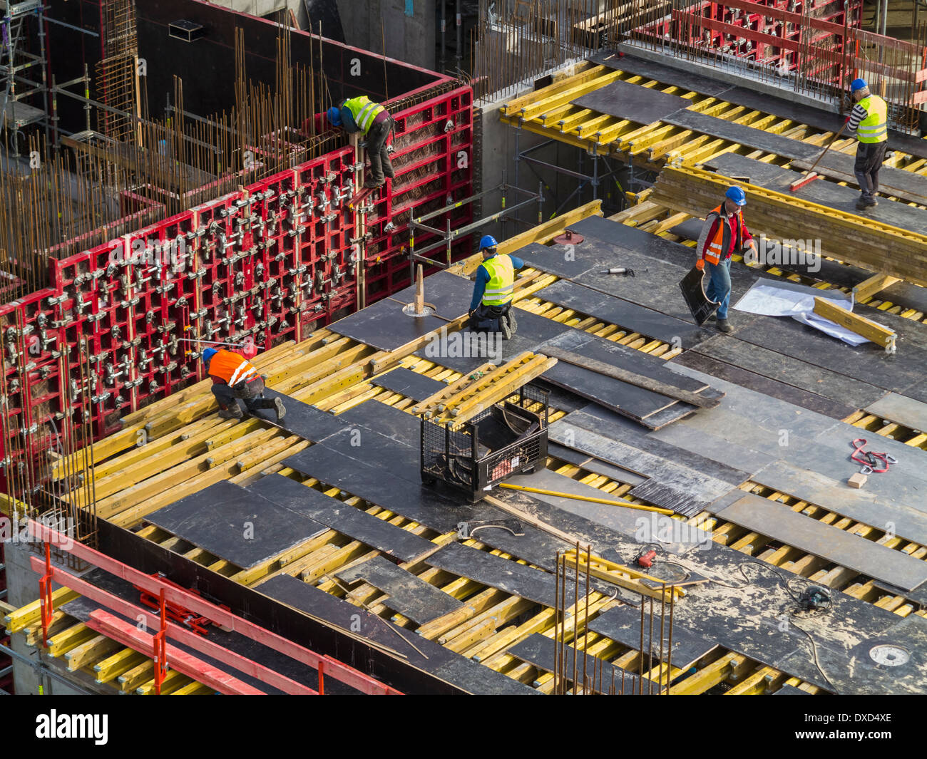 Construction site work in a city centre, construction workers working - Stock Image