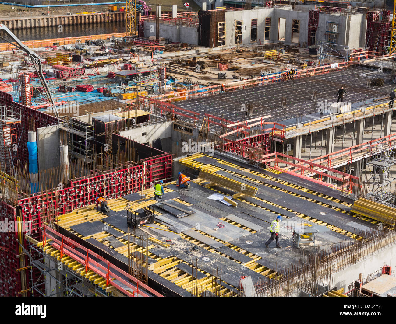 Construction site work on high-rise buildings on a building site in Berlin city centre, Germany, Europe - Stock Image