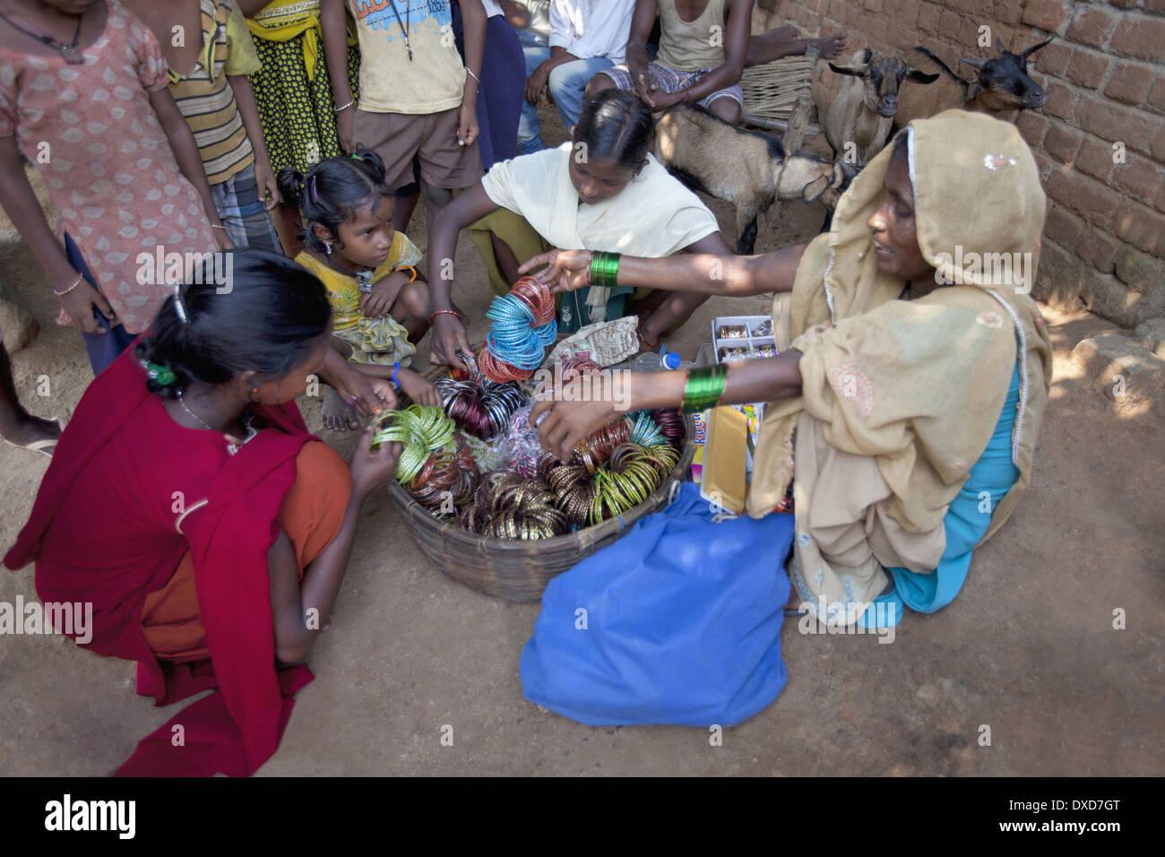 Tribal women and girls purchasing bangles  Santhal tribe