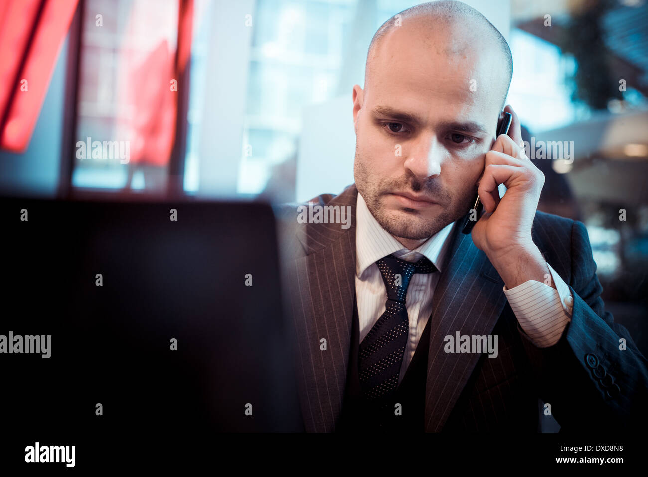 successful elegant fashionable businessman in business district - Stock Image