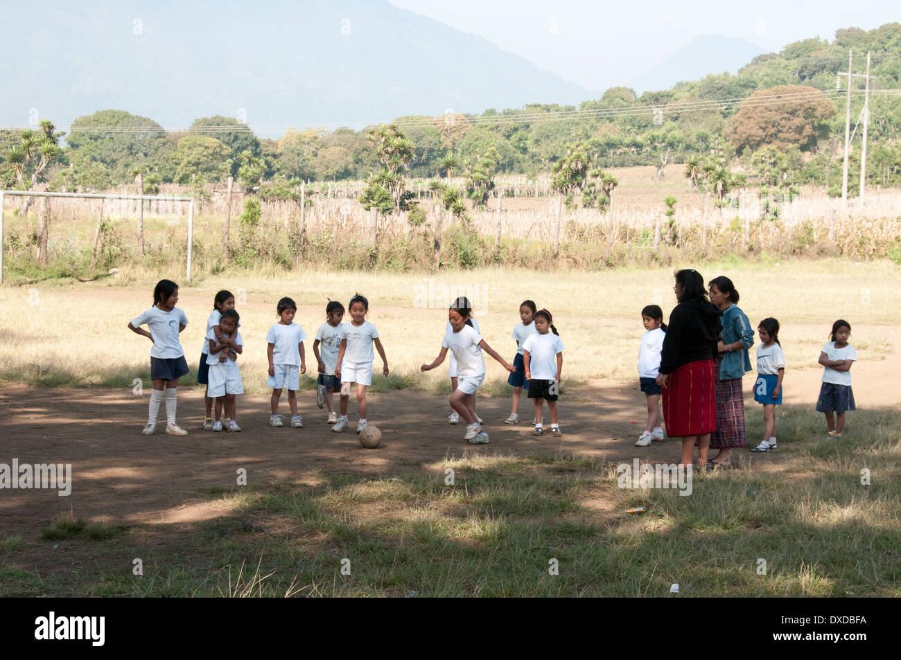 Schoolgirls in Guatemala playing soccer - Stock Image