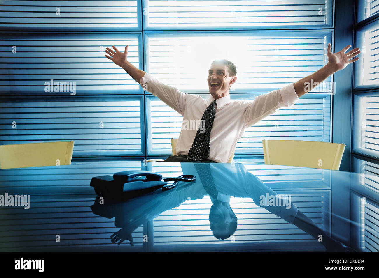 Businessman rejoicing at desk Stock Photo