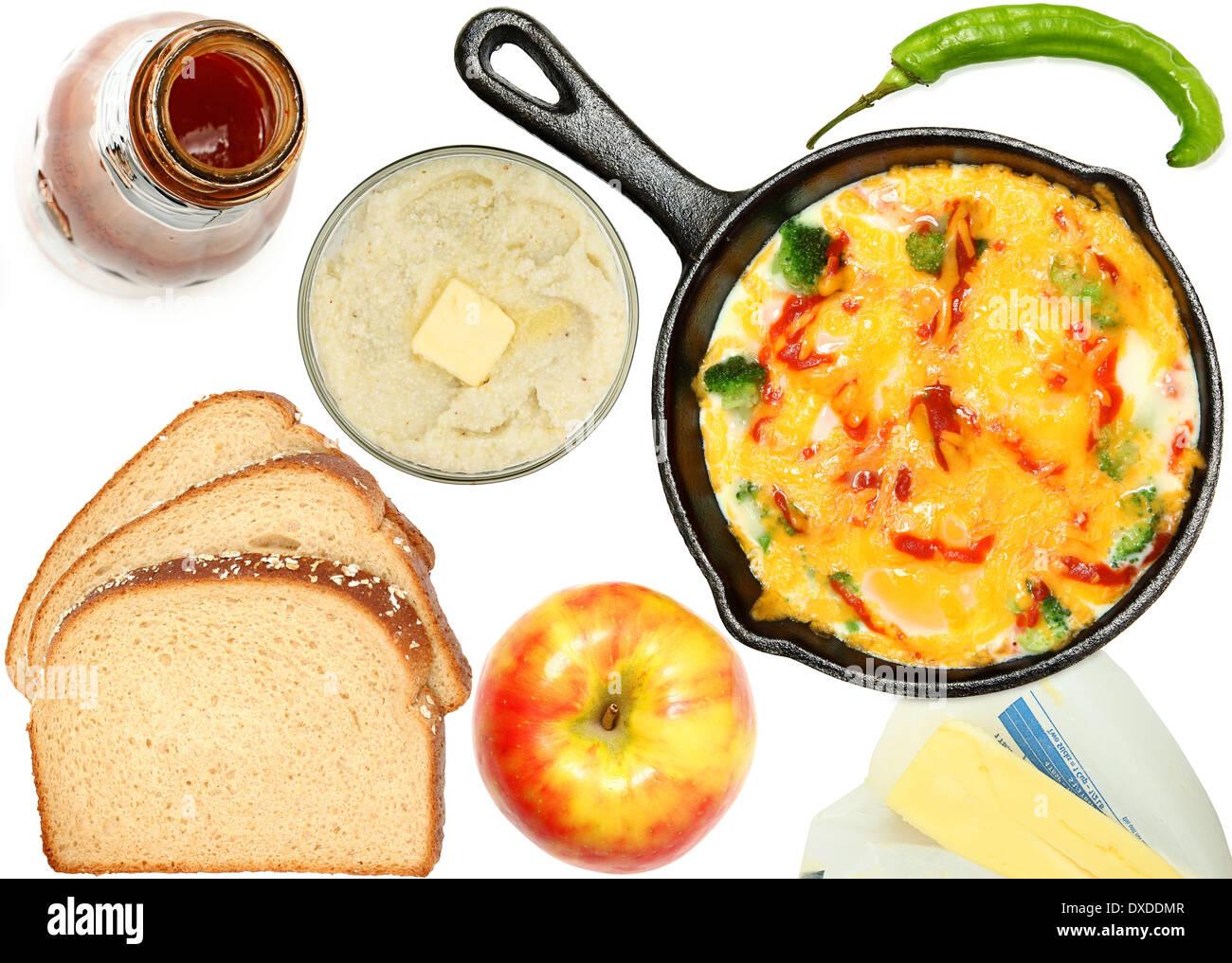 Breakfast over white, omelet, apple, egg, butter, bread, hot sauce, pepper. - Stock Image