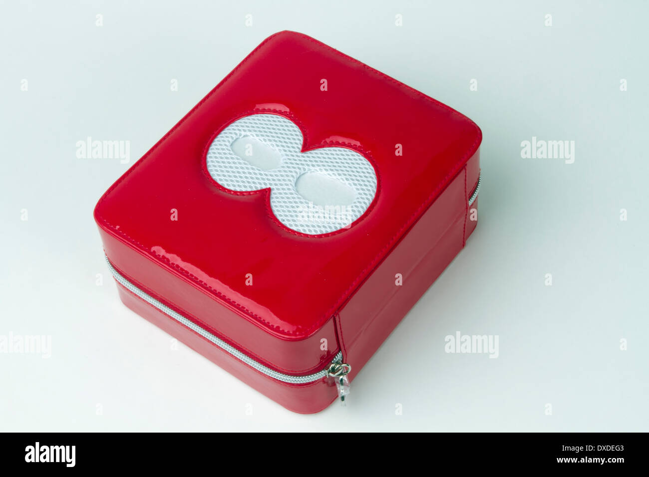 Red plastic zipped make up box with the figure eight etched in its
